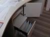 Hangmaplade en schuifplank achter een draaideur